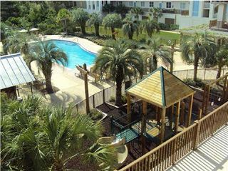 Santa Rosa Beach condo photo - Wonderful playground and pool area. Redfish Lake is just steps away!