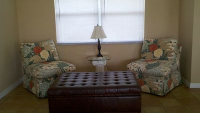 This nicely appointed family room is great for reading, games, or relaxation