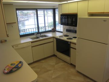 The Kitchen is fully equipped, With a View of the Bay