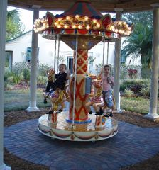 Clermont estate photo - 1 of 3 motorized carousel horses