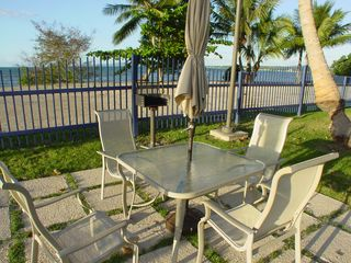 Cabo Rojo apartment photo - BBQ seating area next to the beach.