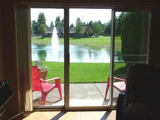 Twin Lakes condo photo - View from the living room of the golf course, trout pond, and patio.
