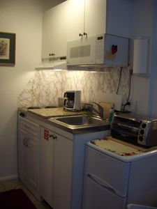 Full Kitchen-new furniture, fridge, toaster/oven, granit working space.