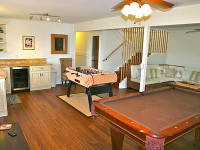 Downstairs entertainment room. Fooseball and pool & TV room & wet bar