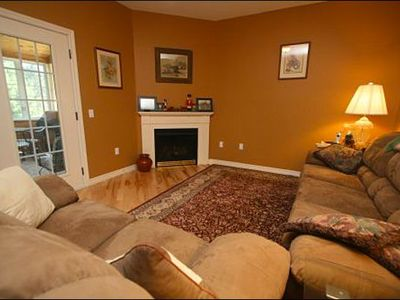 Spacious Living Room Includes a Gas Fireplace and Open to the Sun Room
