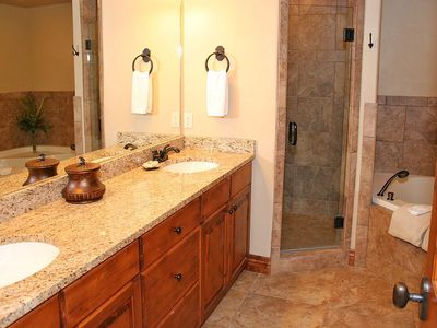 Grand Master Bath with granite counters, double sink, walk-in shower