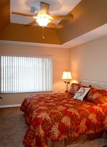 Master bedroom with trayed ceiling, new ceiing fan, carpet, paint, etc.