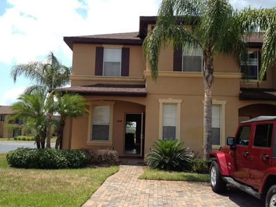 Regal Palms townhome rental - Curbside View - beautiful sunny end unit with driveway, close to resort pool.