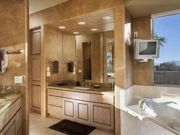 Indulgent master bathroom with jacuzzi tub and unforgettable views