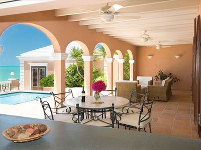 Poolside covered loggia with outside dining and lounging at Villa Palermo
