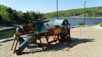 Branson West lodge rental - This play area is next to the pool and Pavilion and includes sand volleyball!