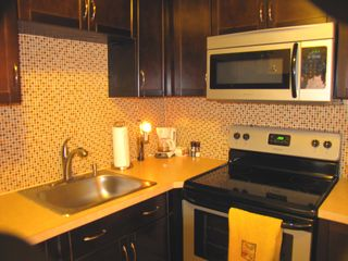 Laconia condo photo - New modern kitchen with stainless steel appliances