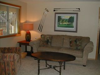 Sunriver house photo - Golf themed lower level family room with queen sleeper sofa. Opens to patio.