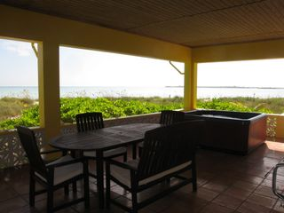 More dining space, jacuzzi, on a shady beach verandah. You're really on vacation - Spanish Wells villa vacation rental photo
