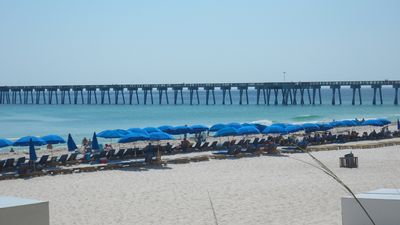 FREE beach service with rental includes 2 cushioned beach chairs w/ umbrella!