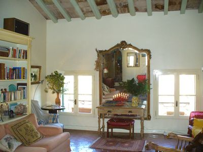 Livingroom with windows to the Place aux Herbes