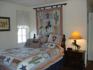 cowboy themed bedroom with queen bed
