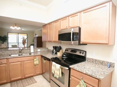 Designer kitchen - granite countertops, stainless steel appliances, pantry.