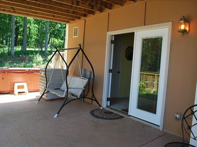 Front porch with swing set and jacuzzi