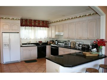Spacious gourmet kitchen, fully-equipped and suited for the best of chefs.