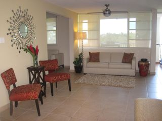 Aguadilla apartment photo - Living area with a queen size sofa bed, ceiling fan and A/C.