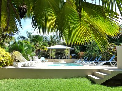 The pool and gardens are the centerpiece of Bravos Beach Cottages.