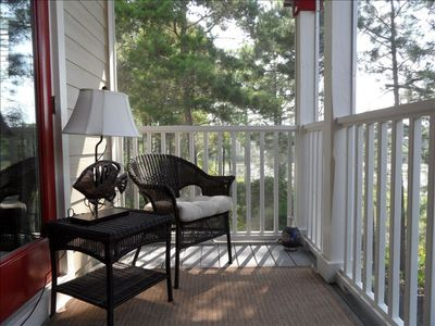 Screened porch off master BR with view of lake