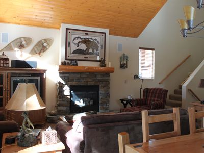 Cozy and professionally decorated family room with gas fireplace.