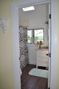 Upstairs full bath, newly renovated, heated floors, tub/shower. Lake views