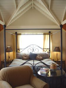 Master Bedroom with Vaulted Ceiling and French Doors Opening to the Deck