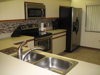 Cocoa Beach condo photo - Newly renovated kitchen with all new stainless steel appliances