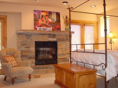 Master bedroom has a stone fireplace and access to outdoor spa.