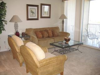 Vanderbilt Beach condo photo - Living area with games, large flat screen, and Blu-Ray disc player