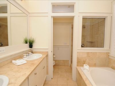 Master salon bath with his/her vanities, jacuzzi tub and separate walk-in shower
