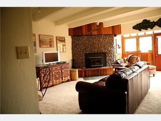 Taos Ski Valley condo photo - Cozy living area with a fireplace