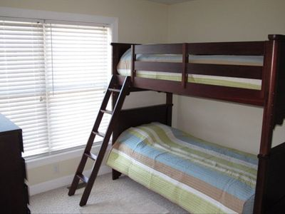 Bunk bed featuring adult sized twins.