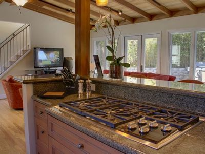 Gourmet kitchen with 5 burner Wolf gas stove.