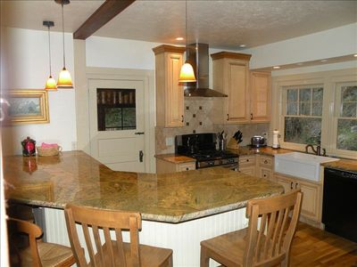 Gorgeous granite counter tops and gas stove.