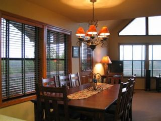 Dining Room on Main Level Opens to Family Room with Spectacular Views