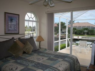 Vacation Homes in Marco Island house photo - Bedroom #2 with King Bed & TV overlooks lagoon