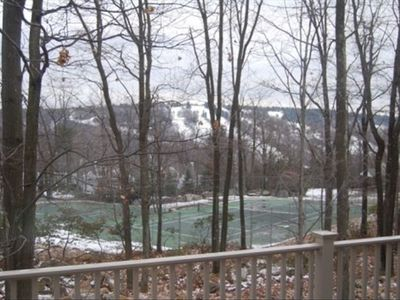 view from deck of tennis courts and ski slopes