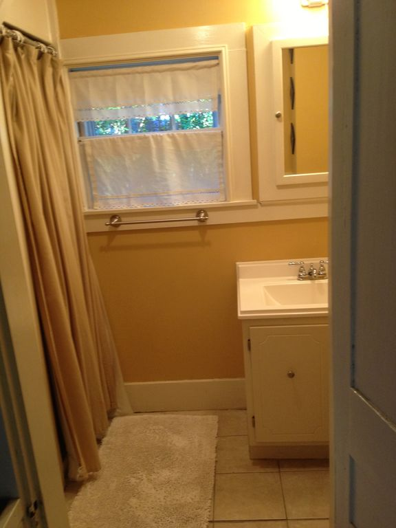 The downstairs bathroom is located adjacent to the kitchen.