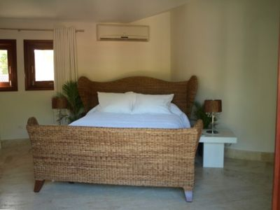 Upstairs Queen Bed Suite with private balcony and ensuite bath.