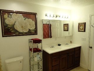 Master Bath with double vanity - Gulfport house vacation rental photo