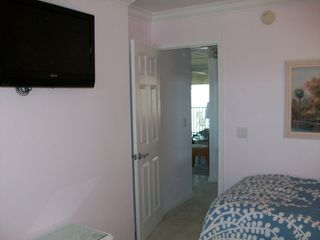 Sanibel Island condo photo - Three HDTVs make your later evenings entertainment.