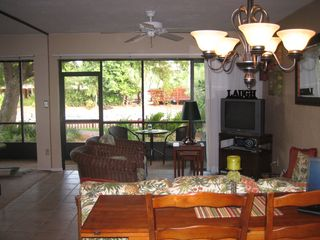 Naples condo photo - View from Kitchen. Pool is behind the trees, very close!!!