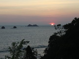 Ojochal villa photo - View of Tres Hermanas from Coastal Highway at sunset; less than 5 minutes north
