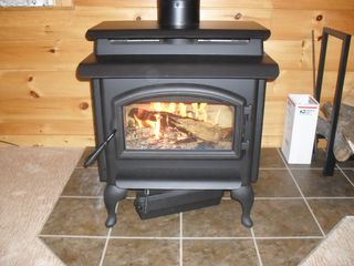 Greenville cabin photo - First fire in the newly installed wood burning stove.