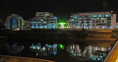 A view to the Dockside Green development across the ocean at night.