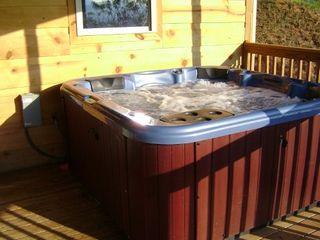 Helen cabin photo - Hot tub on lower level